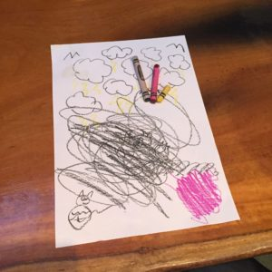 a piece of paper with crayon scribbles we use to teach our creative workshops